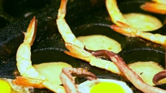 Slow motion of vendor cooking fried quail eggs with squid tentacles-Dan Stock Footage