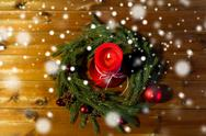 Fir branch wreath with candle on wooden table Stock Photos