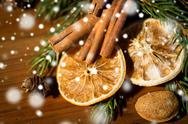 Christmas fir branch, cinnamon and dried orange Stock Photos