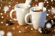 Cups of hot chocolate with marshmallow on wood Stock Photos