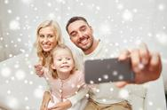 Family taking selfie with smartphone at home Stock Photos