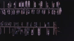 Overhead Aerial of Various Boats Docked at Marina in the Evening Stock Footage