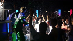 4k, man in a luminous  suit dancing with people at the disco 2 Stock Footage