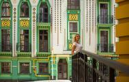 Woman standing near a beautiful building Stock Photos
