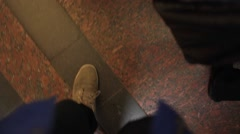 Man enters the subway car. POV up view shoes and feet Stock Footage