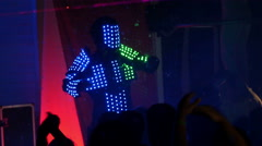4k, man in a luminous robot suit dancing at the disco 2 Stock Footage