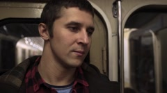 Close up of young man riding by the subway Stock Footage
