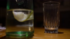 4K Waiter Serving a Water Glass with lemon in the restaurant with wood table-Dan Stock Footage