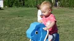 Little girl playing on seesaw. Stock Footage