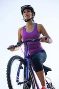 Female cyclist cycling in countryside Stock Photos