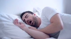 Man is sleeping in his bed at night and is snoring. Stock Footage