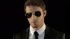 Man looks over his sunglasses like special agent Stock Footage