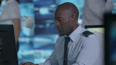 4K Portrait smiling surveillance officer in control room Stock Footage