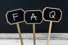 Business message FAQ as Frequently Asked Questions Stock Photos