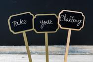 Motivational message Take Your Challenge written with chalk Stock Photos