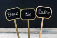 Motivational message Break The Rules written with chalk Stock Photos