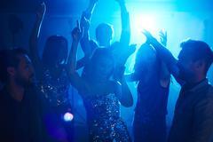 Posh friends enjoying disco in club Stock Photos