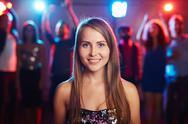Posh girl with long hair looking at camera at party Stock Photos
