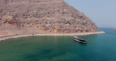 Abandoned boat and road Musandam Sultanate of Oman Stock Footage