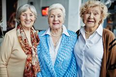 Three happy grannies looking at camera Stock Photos
