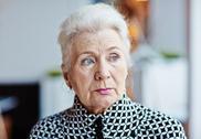 Grey-hair grandmother with natural make-up Stock Photos