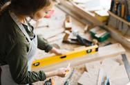 Young woman working as carpenter Stock Photos