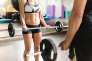Sporty man and woman lifting weight Stock Photos