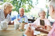 Hangout of senior man and women in cafe Stock Photos