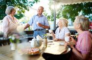 Happy senior friends having tea in cafe Stock Photos