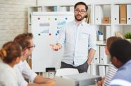 Confident coach motivating young managers Stock Photos
