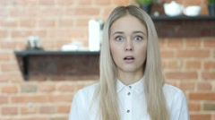 Shock, Upset Beautiful Brunette Woman on Indoor Stock Footage