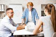 Successful young teacher consulting managers at seminar Stock Photos