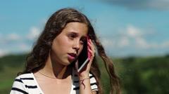 Sad girl talks on smartphone Stock Footage
