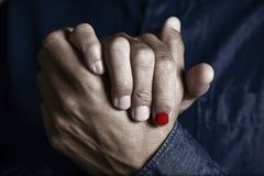 Man with a polished fingernail Stock Photos