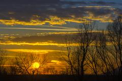 Landscape Dramatic sunset and sunrise sky with a silhouette of trees Stock Photos
