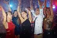 Dancing friends clubbing at disco Stock Photos