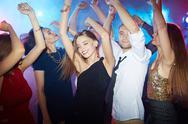 Ecstatic young people enjoying disco dancing Stock Photos