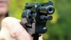 Man holds in hands black revolver Stock Footage