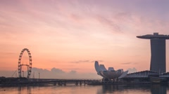 Marina bay sands singapore flyer sunrise from clouds Stock Footage