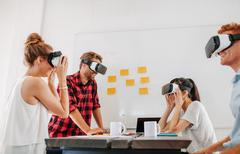 Business colleagues brainstorming using VR goggles Stock Photos