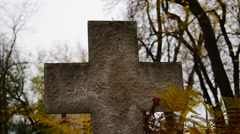Stone cross in a cemetery - close Stock Footage