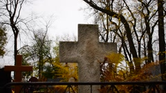 Stone cross in a cemetery Stock Footage