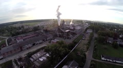 Flying over an industrial enterprise, a tube, a couple of people. Stock Footage