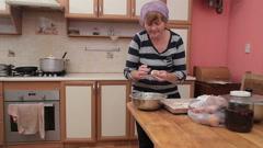 Woman Preparing Vareniki Or Dumplings Pierogi On Wooden Bord For Boiling. Cook Stock Footage