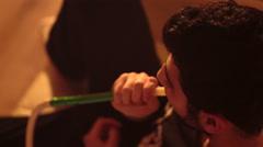 Man smokes a hookah Stock Footage