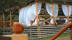 Bower with curtains made of logs Stock Footage