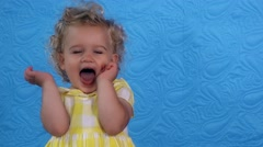 Emotional toddler girl play-act simper looking at camera Stock Footage