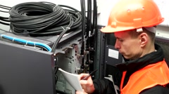 Male engineer of carries out an inspection server. Switch Lever On A Control Stock Footage