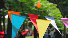 Beautiful colorful festive summer park decoration from paper.  Stock Footage