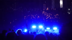 Lots of people at the concert in the night outside in the park. Stock Footage
